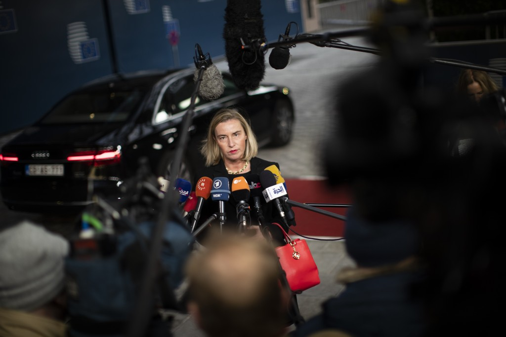 European Union Foreign Policy chief Federica Mogherini talks to journalists as she arrives to an European Foreign Affairs Ministers meeting at the Eur...