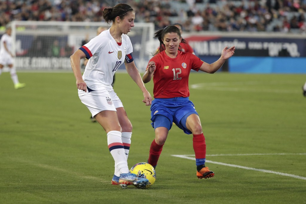 U.S. forward Carli Lloyd, left, works for possession against Costa Rica defender Lixy Rodriguez (12) during the first half of an international friendl...