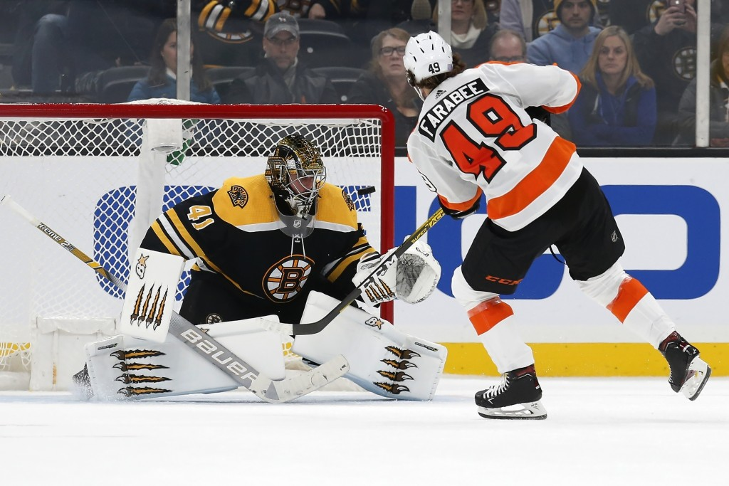 Philadelphia Flyers' Joel Farabee (49) scores on Boston Bruins' Jaroslav Halak (41) during the shootout in an NHL hockey game in Boston, Sunday, Nov. ...