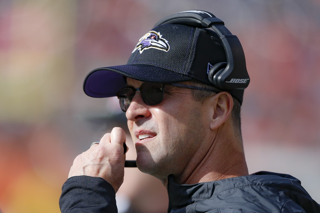 Baltimore Ravens head coach John Harbaugh works the sidelines during the first half of NFL football game against the Cincinnati Bengals, Sunday, Nov. ...