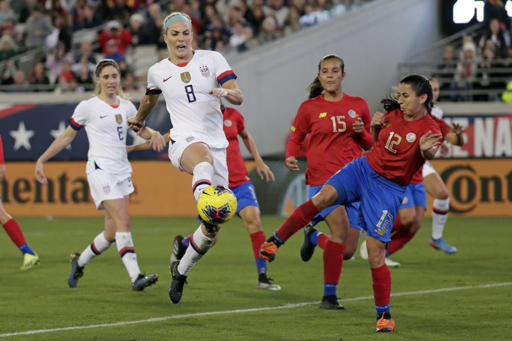 U.S. midfielder Julie Ertz (8) attempts a shot on goal off a corner kick, against Costa Rica defender Lixy Rodriguez (12) during the first half of an ...