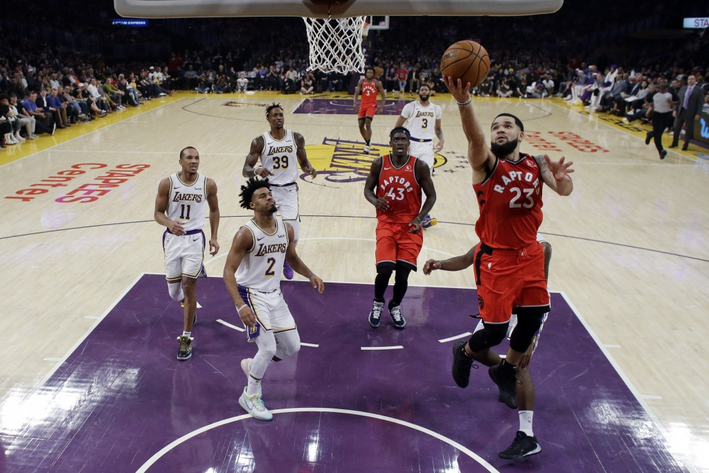 Toronto Raptors' Fred VanVleet (23) scores against the Los Angeles Lakers during the first half of an NBA basketball game Sunday, Nov. 10, 2019, in Lo...