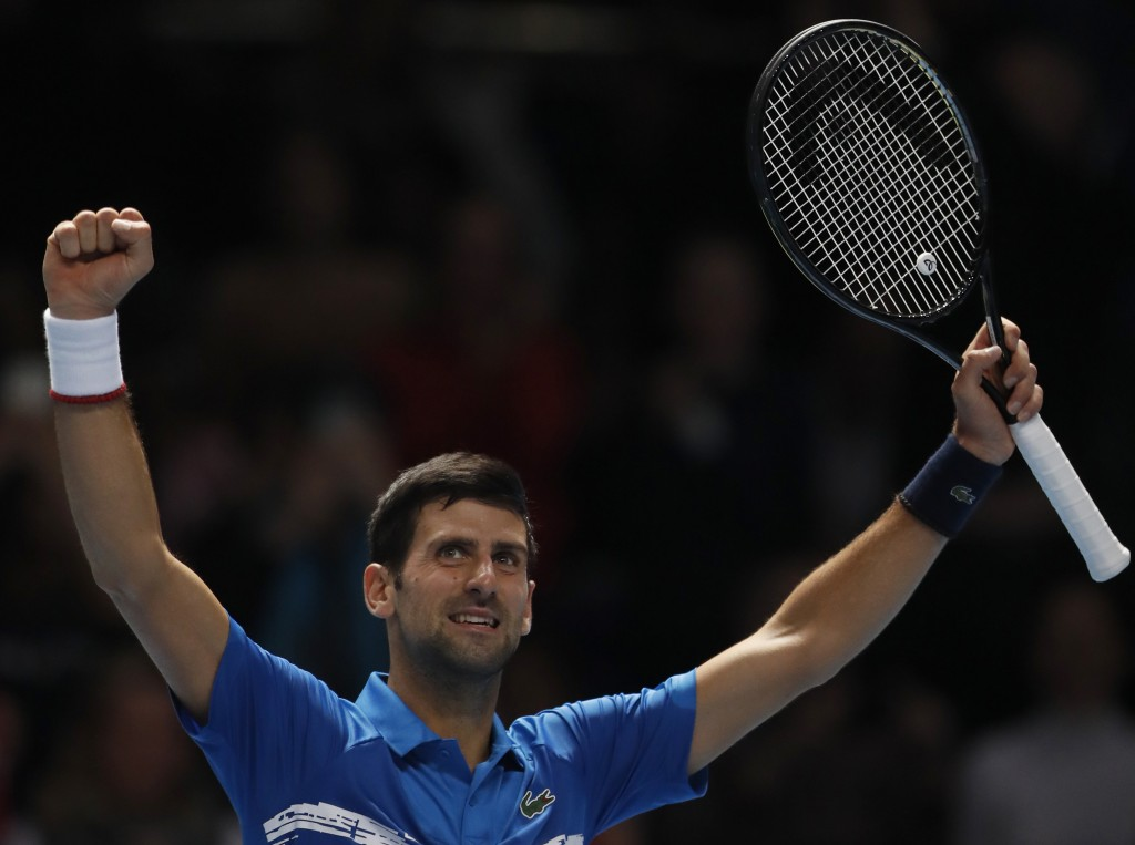 Serbia's Novak Djokovic celebrates after defeating Italy's Matteo Berrettini in their ATP World Tour Finals singles tennis match at the O2 Arena in Lo...