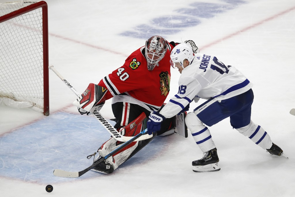 Chicago Blackhawks' Robin Lehner, left, makes a save on Toronto Maple Leafs' Andreas Johnsson during the second period of an NHL hockey game Sunday, N...