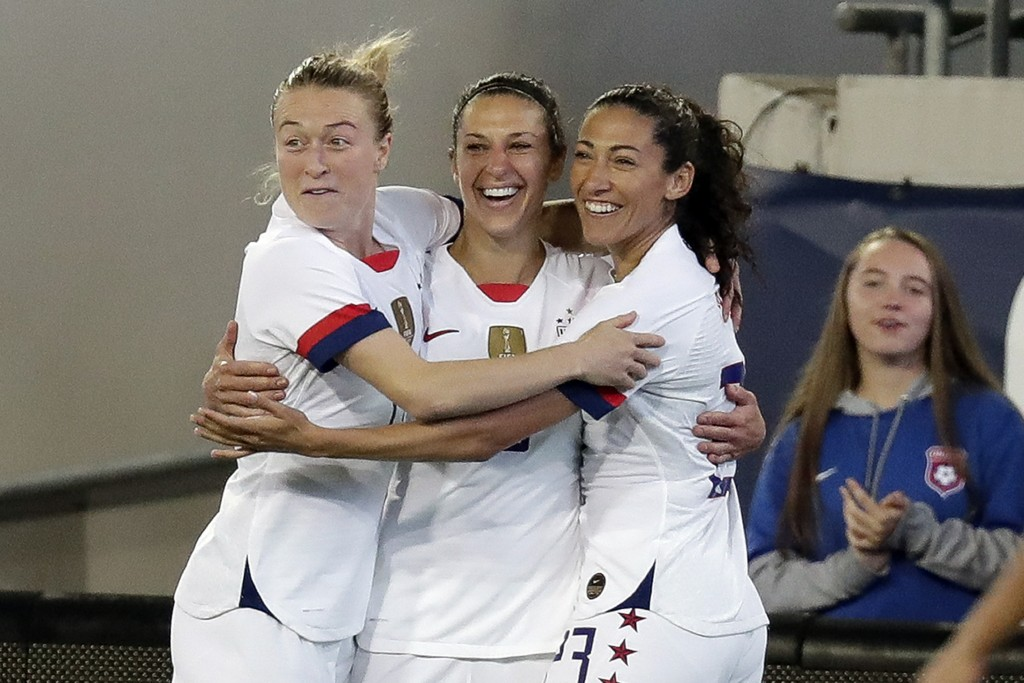 U.S. forward Carli Lloyd, center, celebrates her goal against the Costa Rica with Emily Sonnett, left, and Christen Press during the first half of an ...