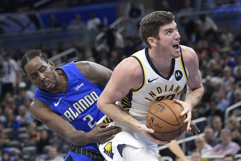 Indiana Pacers forward T.J. Leaf (22) drives to the basket past Orlando Magic forward Al-Farouq Aminu (2) during the second half of an NBA basketball ...