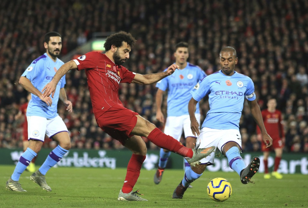 Liverpool's Mohamed Salah makes an attempt to score during the English Premier League soccer match between Liverpool and Manchester City at Anfield st...