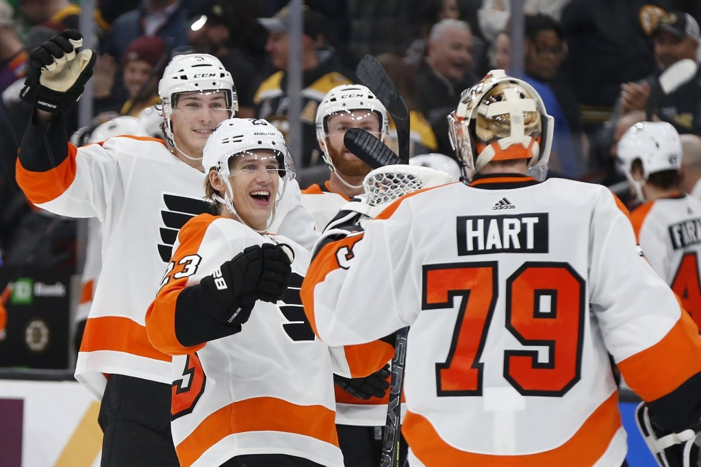 Philadelphia Flyers' Oskar Lindblom (23) and teammates celebrate with goalie Carter Hart (79) after defeating the Boston Bruins in a shootout during a...