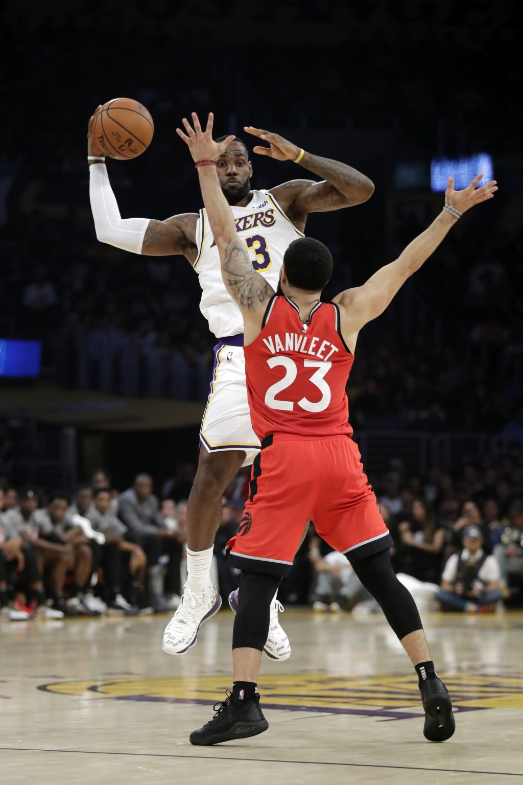 Los Angeles Lakers' LeBron James, rear, is defended by Toronto Raptors' Fred VanVleet during the first half of an NBA basketball game Sunday, Nov. 10,...