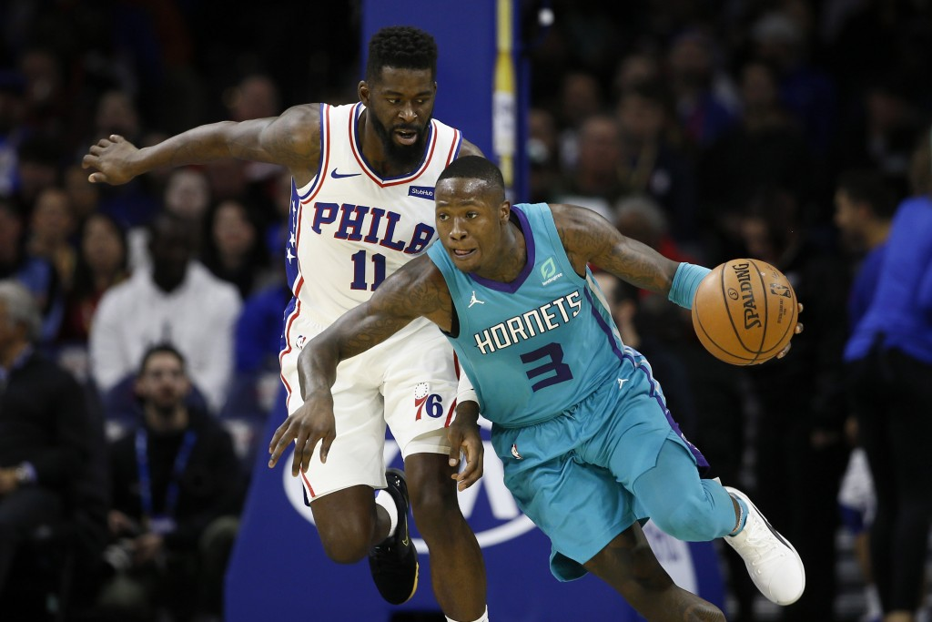 Charlotte Hornets' Terry Rozier (3) dribbles past ...