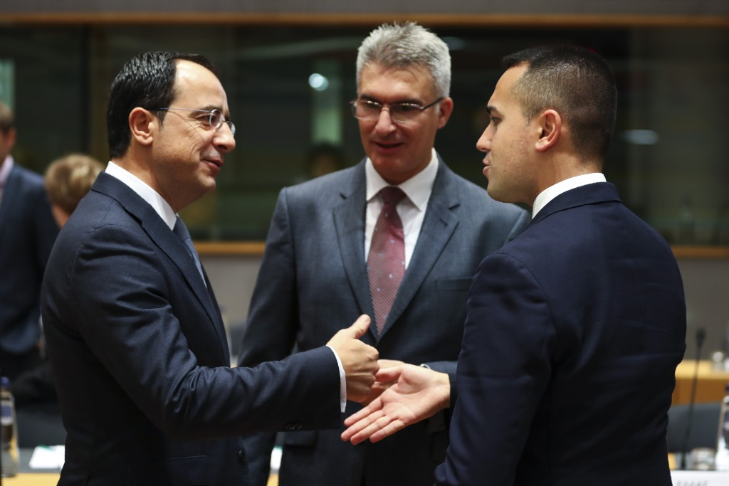 Italian Foreign Minister Luigi Di Maio, right, talks to Cyprus' Foreign Minister Nicos Christodoulides, left, and Malta's Foreign Minister Carmelo Abe...