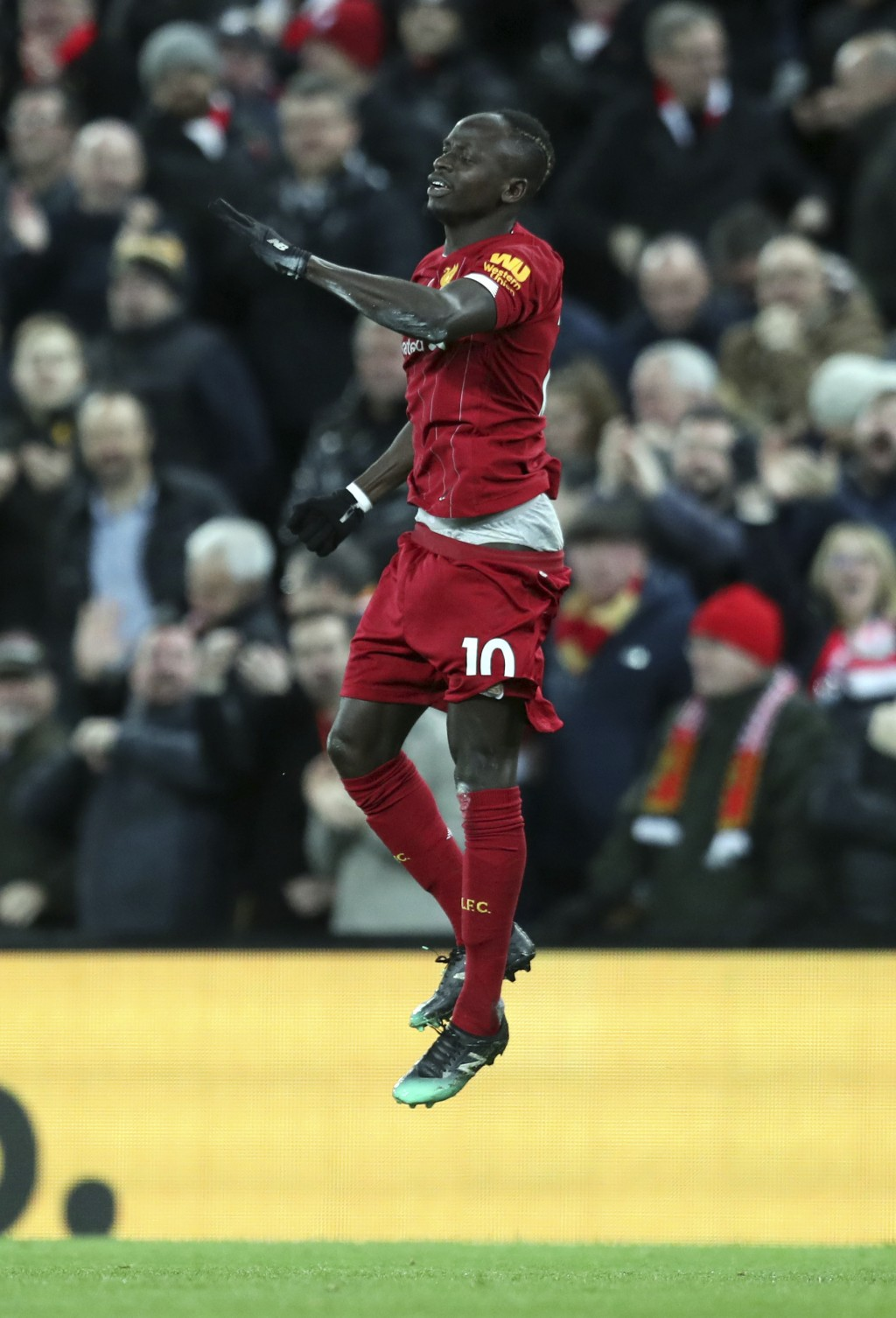 Liverpool's Sadio Mane celebrates after scoring his side's third goal during the English Premier League soccer match between Liverpool and Manchester ...