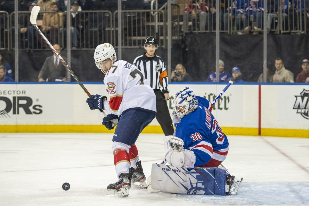 Florida Panthers center Frank Vatrano (77) pressures New York Rangers goaltender Henrik Lundqvist (30) during the first period of an NHL hockey game, ...