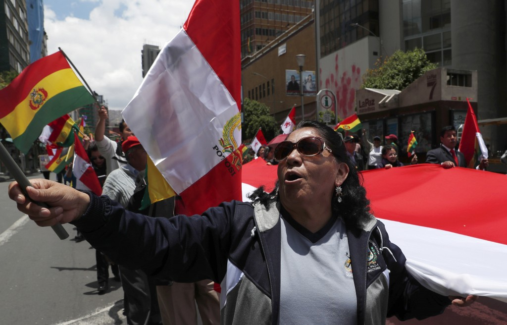 Anti-government protesters march against the reelection of President Evo Morales in La Paz, Bolivia, Sunday, Nov. 10, 2019. President Morales is calli...