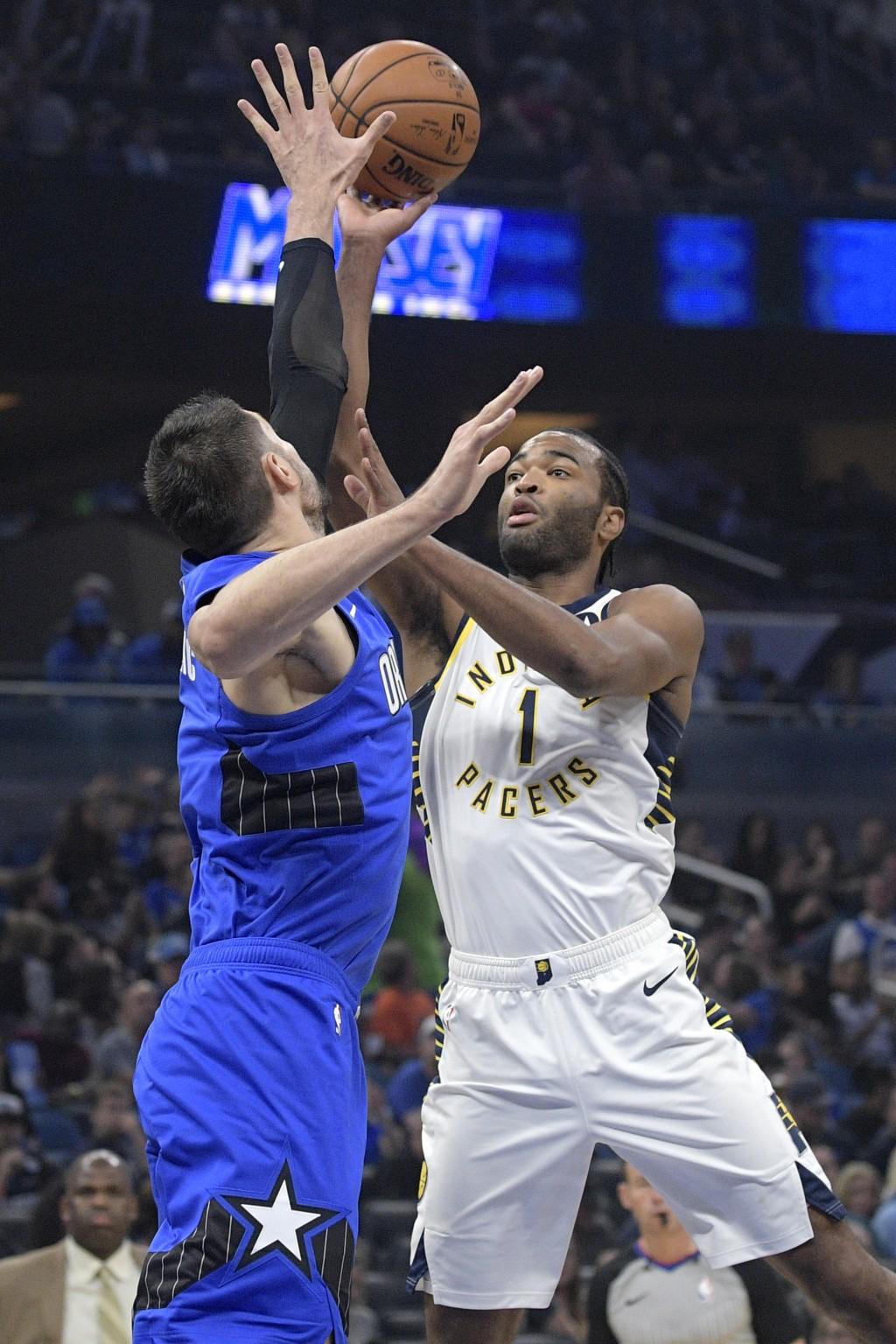 Indiana Pacers forward T.J. Warren (1) shoots over Orlando Magic center Nikola Vucevic during the first half of an NBA basketball game Sunday, Nov. 10...