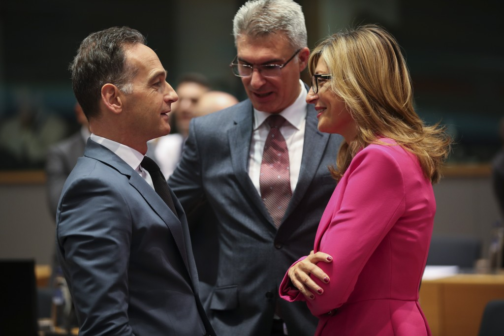 Germany's Foreign Minister Heiko Maas, left, talks to Bulgarian Foreign Minister Ekaterina Zaharieva, right, and Malta's Foreign Minister Carmelo Abel...