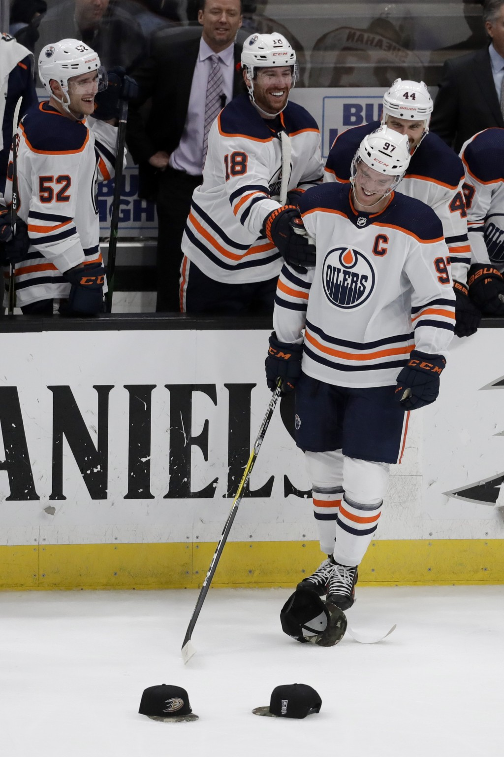 Edmonton Oilers center Connor McDavid celebrates his hat trick against the Anaheim Ducks during the third period of an NHL hockey game in Anaheim, Cal...