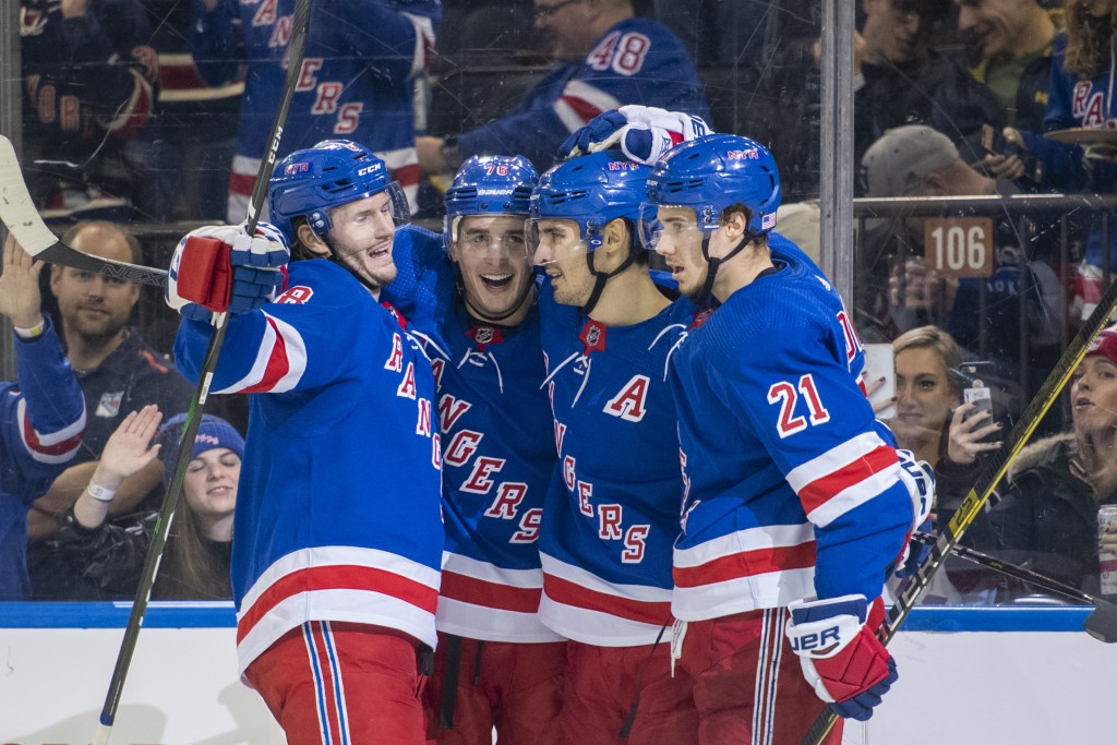 New York Rangers defenseman Brady Skjei (76) celebrates his goal with defenseman Jacob Trouba (8), center Chris Kreider, second from right, and center...