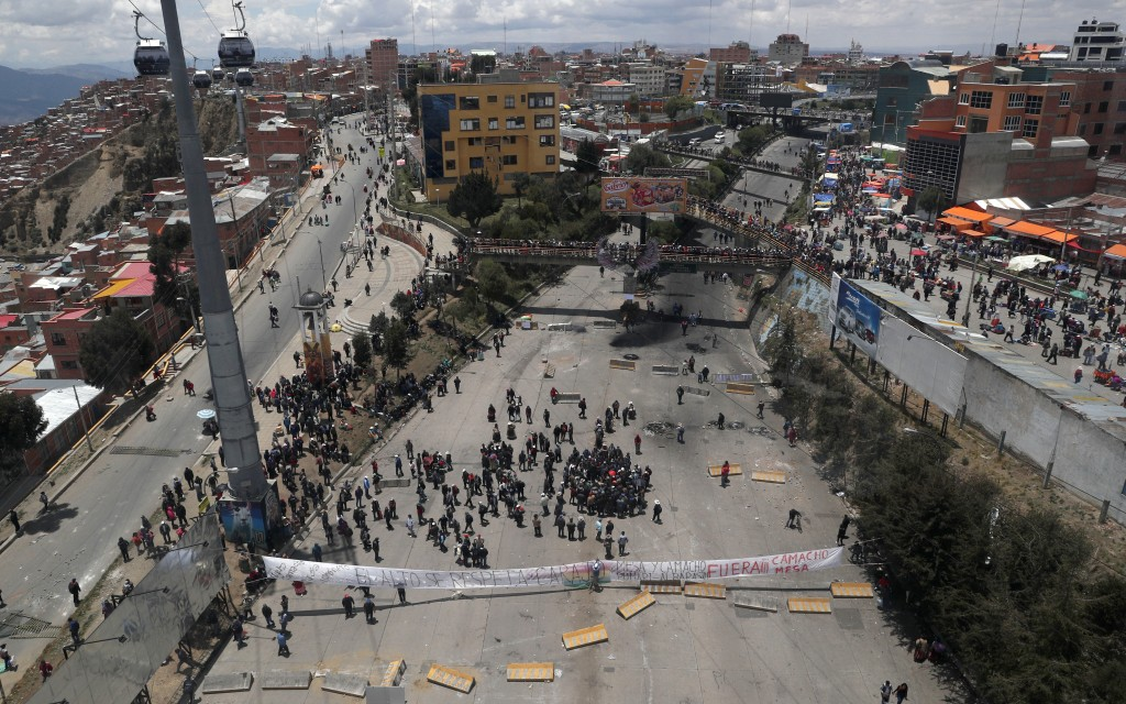 Supporters of Bolivian President Evo Morales block a road that connects La Paz and El Alto, to show their support of his apparent reelection in El Alt...