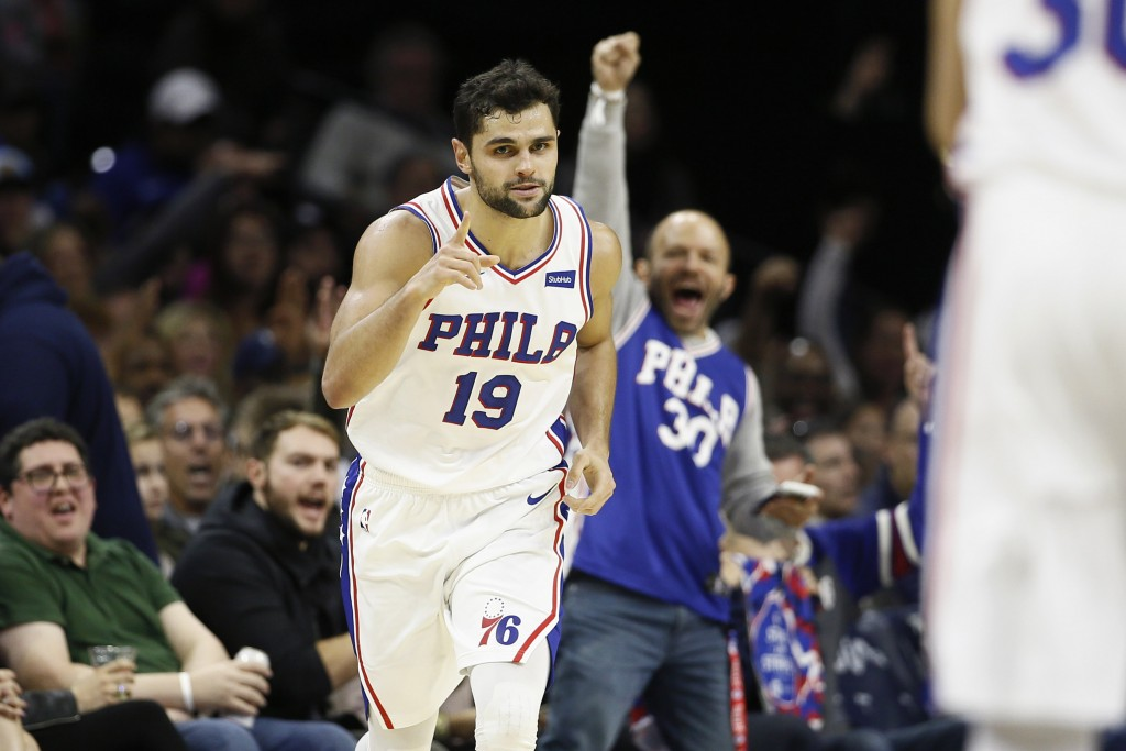 Philadelphia 76ers' Raul Neto points after making a 3-pointer during the first half of the team's NBA basketball game against the Charlotte Hornets, S...