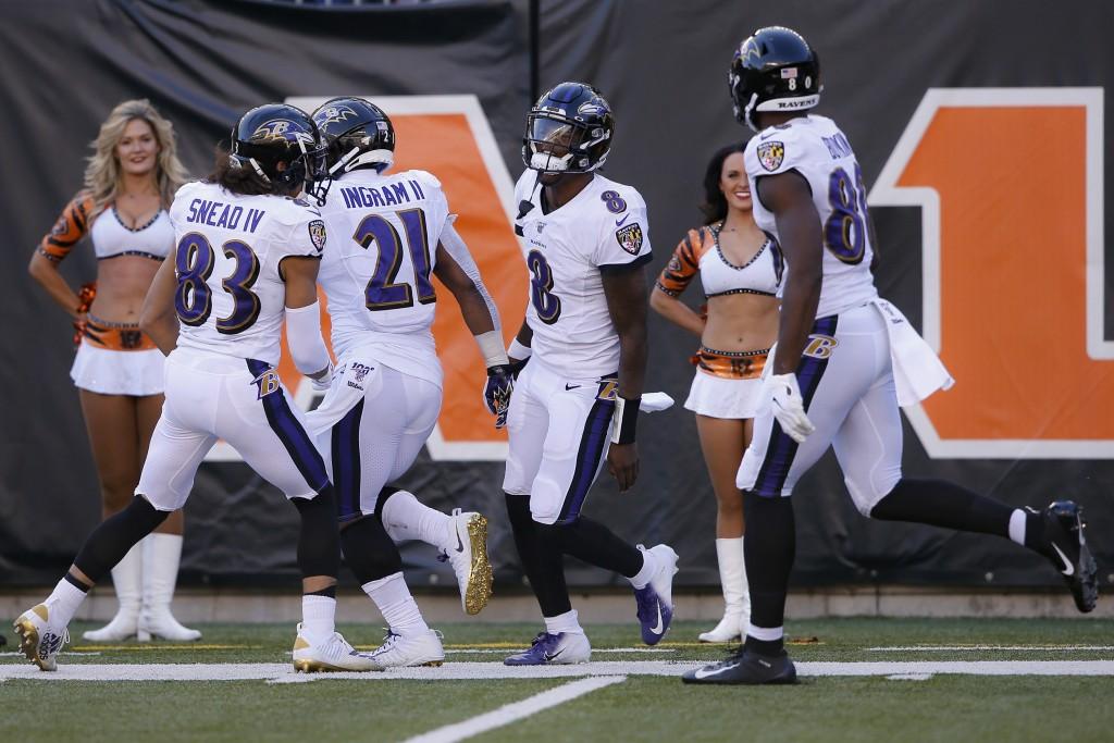 Baltimore Ravens quarterback Lamar Jackson (8) cel...