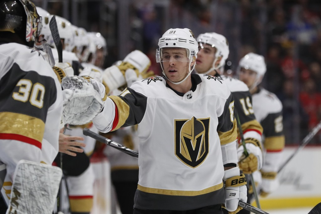 Vegas Golden Knights center Jonathan Marchessault greets teammates after scoring during the first period of an NHL hockey game against the Detroit Red...