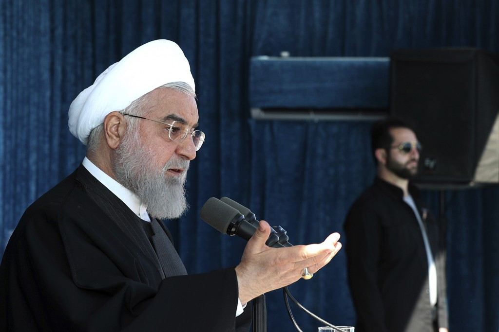 In this photo released by the official website of the office of the Iranian Presidency, President Hassan Rouhani speaks at a public gathering in the c...