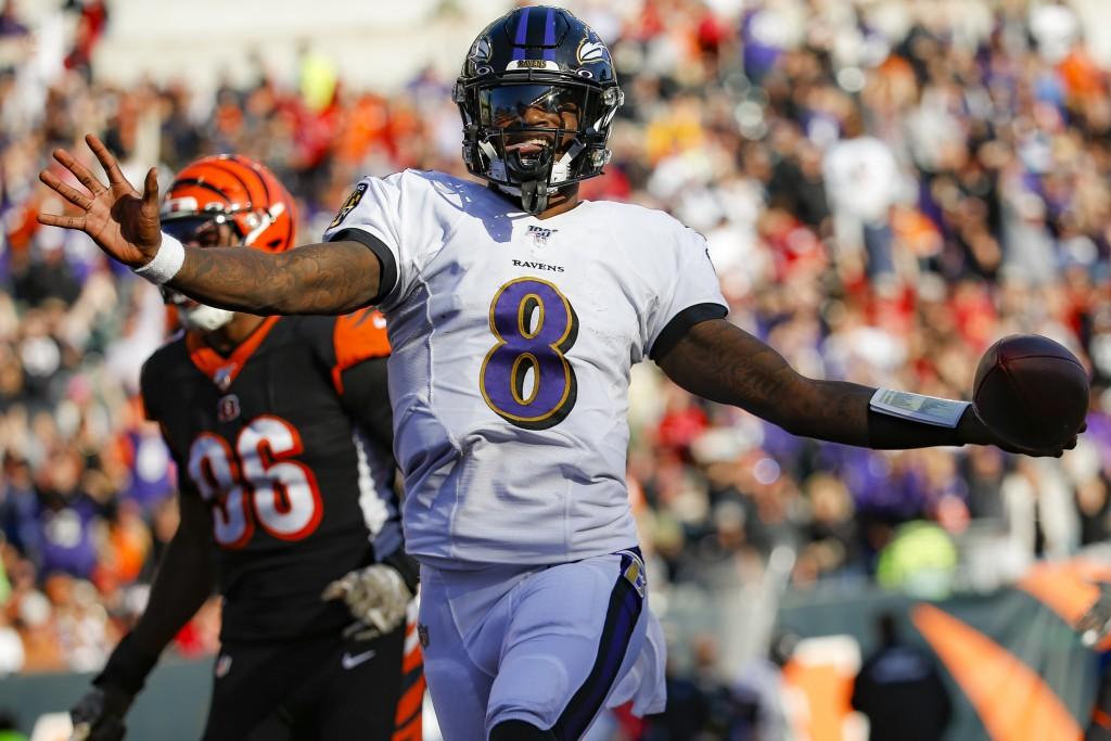 Baltimore Ravens quarterback Lamar Jackson (8) celebrates his touchdown during the second half of NFL football game against the Cincinnati Bengals, Su...