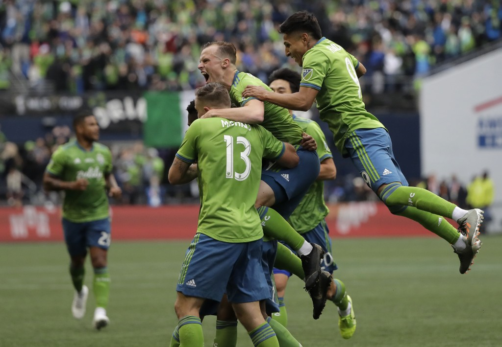Seattle Sounders celebrate after Kelvin Leerdam scored against the Toronto FC, Sunday, Nov. 10, 2019, during the second half of the MLS Cup championsh...