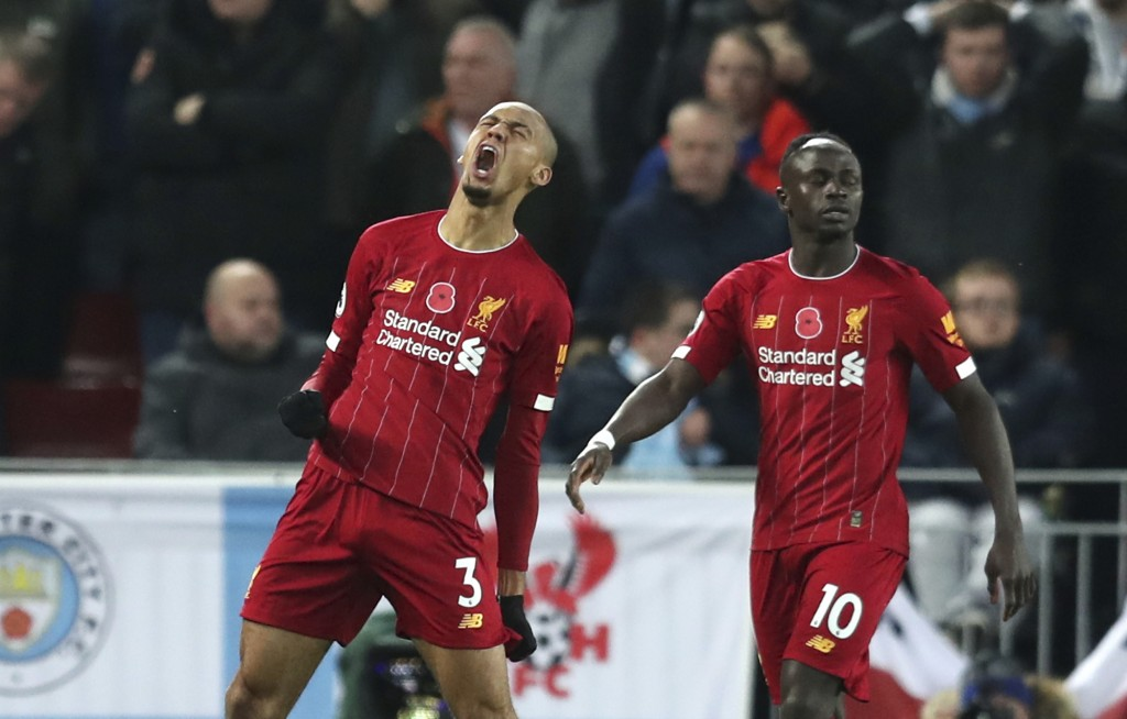 Liverpool's Fabinho celebrates after scoring his side's opening goal during the English Premier League soccer match between Liverpool and Manchester C...