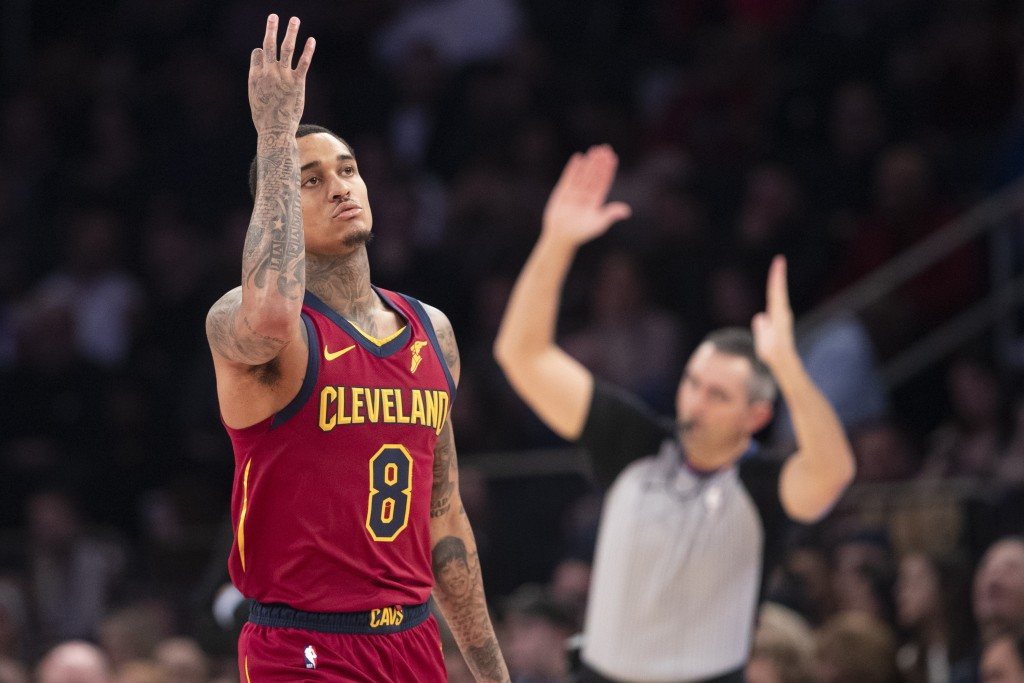 Cleveland Cavaliers guard Jordan Clarkson gestures after sinking a 3-pointer during the first half of the team's NBA basketball game against the New Y...