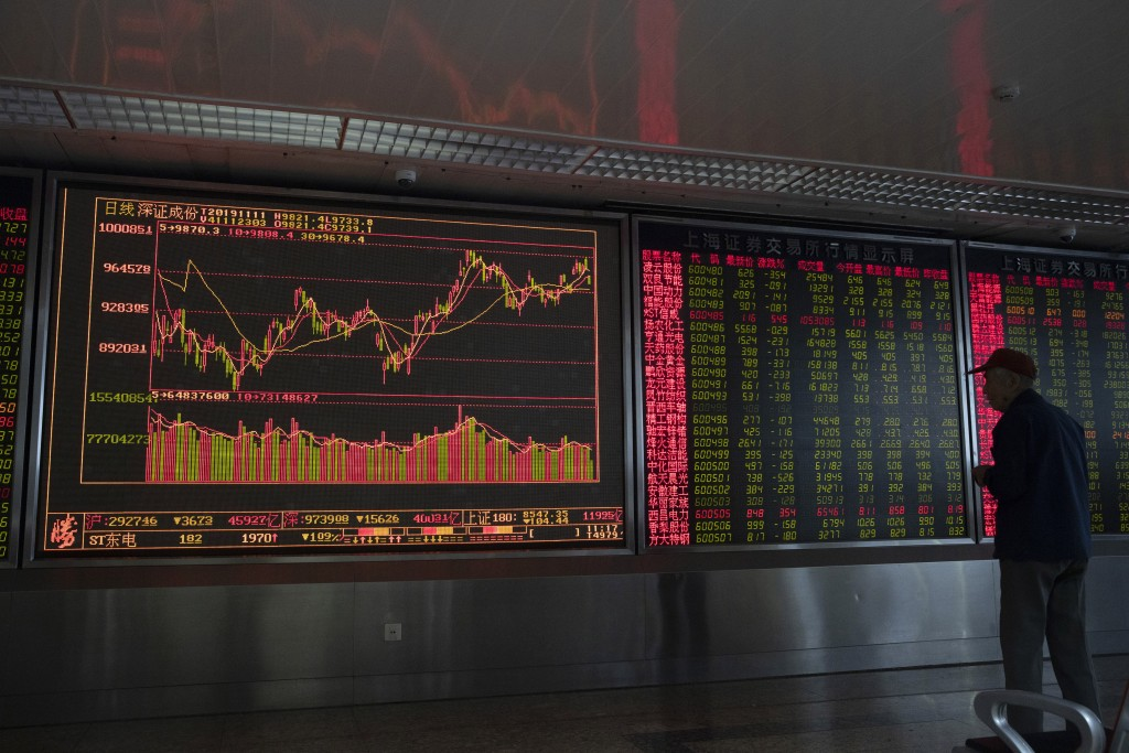 An investor monitors stock prices at a brokerage in Beijing Monday, Nov. 11, 2019. Shares declined Monday in Asia as investors watched for the latest ...