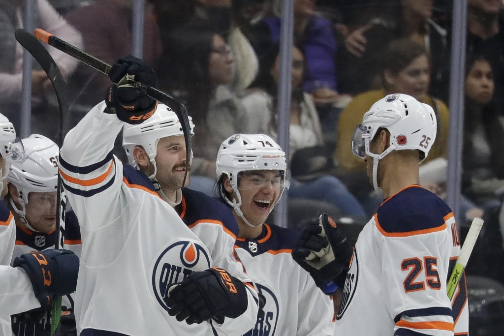 Edmonton Oilers right wing Zack Kassian, left, celebrates his goal with defensemen Darnell Nurse, right and Ethan Bear during the second period of an ...