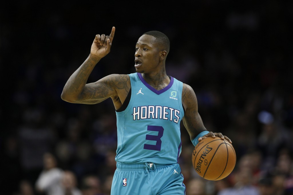 Charlotte Hornets' Terry Rozier directs his team during the first half of an NBA basketball game against the Philadelphia 76ers, Sunday, Nov. 10, 2019...