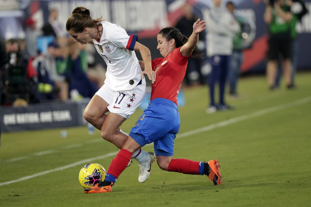Costa Rica defender Lixy Rodriguez, right, tries to get possession of the ball from U.S. forward Tobin Heath (17) during the first half of an internat...