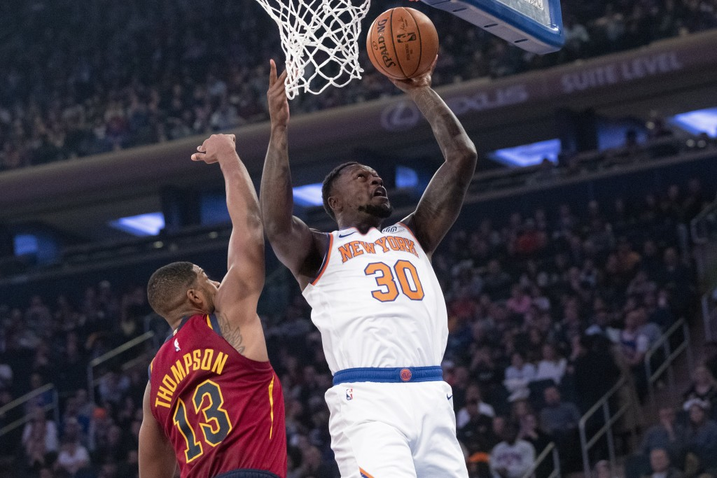 New York Knicks forward Julius Randle (30) goes to...