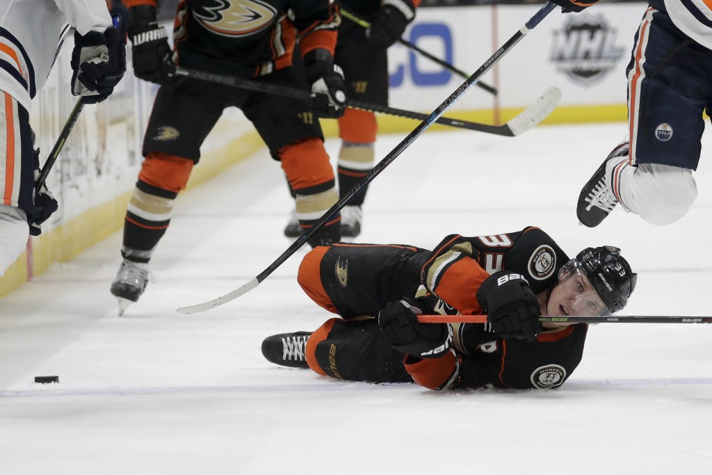 Anaheim Ducks right wing Jakob Silfverberg falls to the ice during the second period of the team's NHL hockey game against the Edmonton Oilers in Anah...