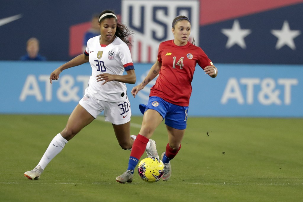 Costa Rica forward Priscilla Chinchilla (14) moves the ball past U.S. forward Margaret Purce (30) during the first half of an international friendly s...