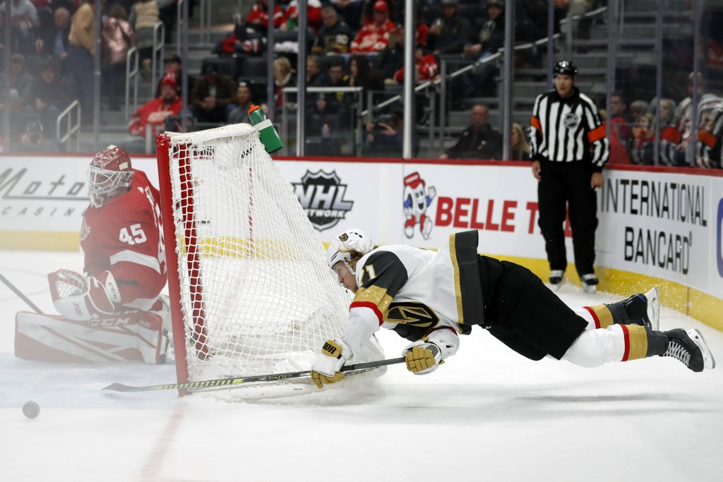 Vegas Golden Knights center William Karlsson (71) attempts a shot against Detroit Red Wings goaltender Jonathan Bernier (45) during the second period ...