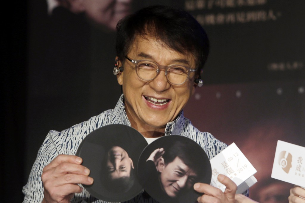 "FILE - In this June 12, 2019, file photo, Hong Kong actor and singer Jackie Chan shows photos during a promotional event announcing his new album ""I A..."