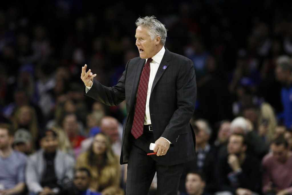 Philadelphia 76ers' Brett Brown yells to his team during the first half of an NBA basketball game against the Charlotte Hornets, Sunday, Nov. 10, 2019...