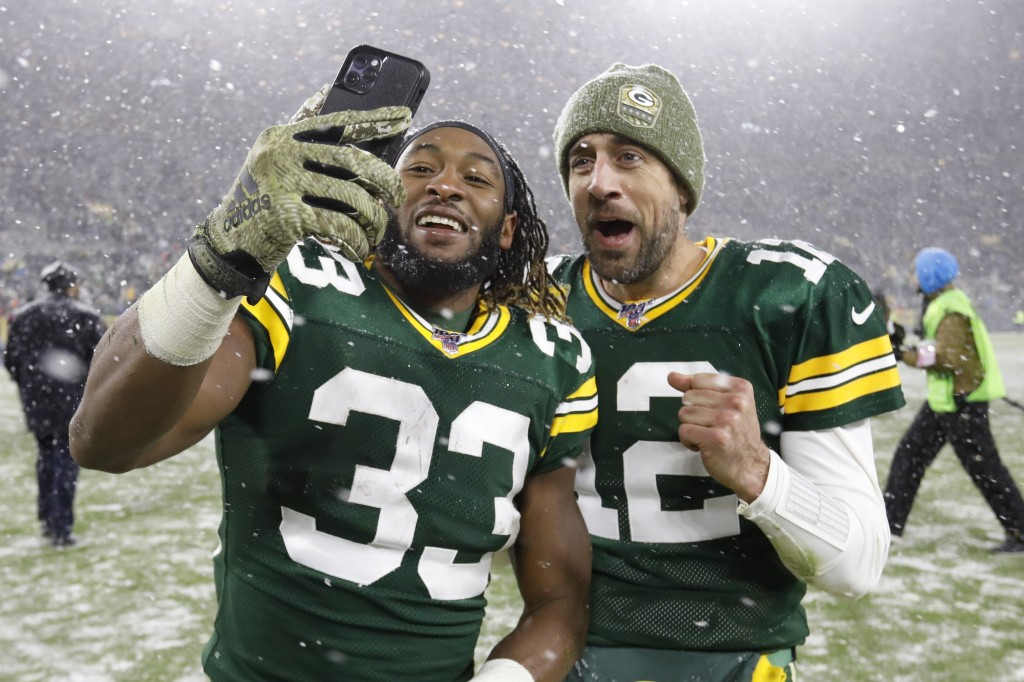 Green Bay Packers' Aaron Jones and Aaron Rodgers take a selfie after an NFL football game against the Carolina Panthers Sunday, Nov. 10, 2019, in Gree...