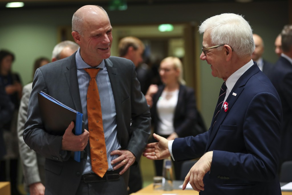 Dutch Foreign Minister Stef Blok, left, talks to Polish Foreign Minister Jacek Czaputowicz during an European Foreign Affairs Ministers meeting at the...