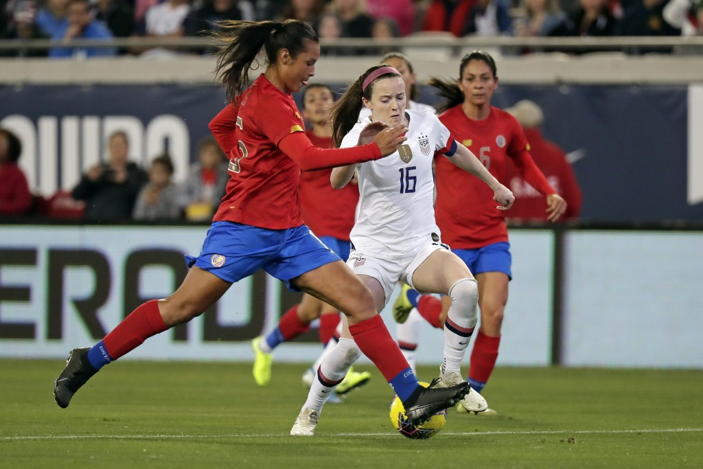 U.S. midfielder Rose Lavelle (16) moves the ball past Costa Rica defender Stephannie Blanco, left, during the first half of an international friendly ...