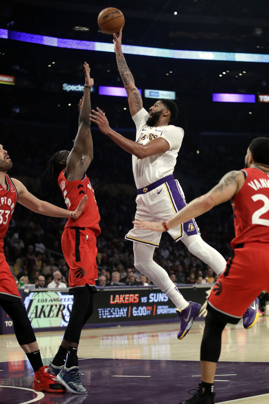 Los Angeles Lakers' Anthony Davis shoots over Toronto Raptors' Chris Boucher during the first half of an NBA basketball game Sunday, Nov. 10, 2019, in...