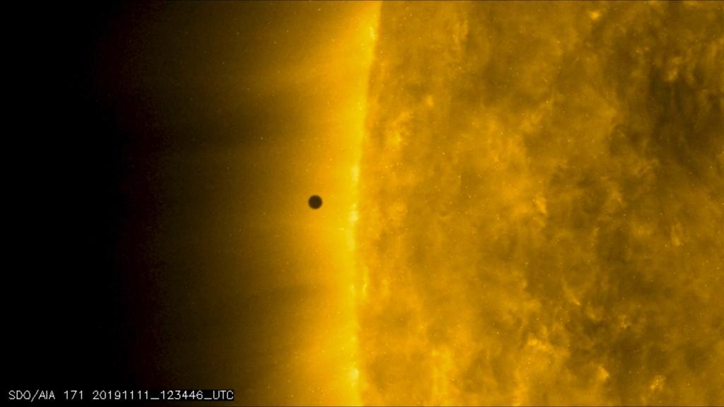 This still image from video issued by NASA's Solar Dynamics Observatory shows Mercury as it passes between Earth and the sun on Monday, Nov. 11, 2019....