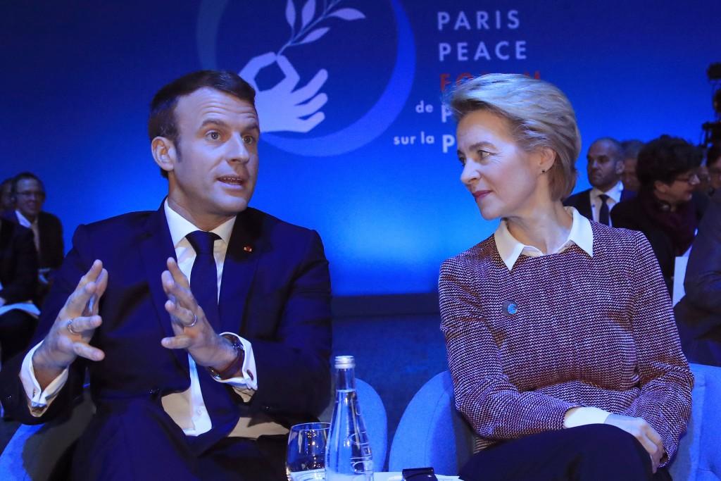 European Commission president Ursula von der Leyen listens to French President Emmanuel Macron at the start of the Paris Peace Forum Tuesday, Nov. 12,...