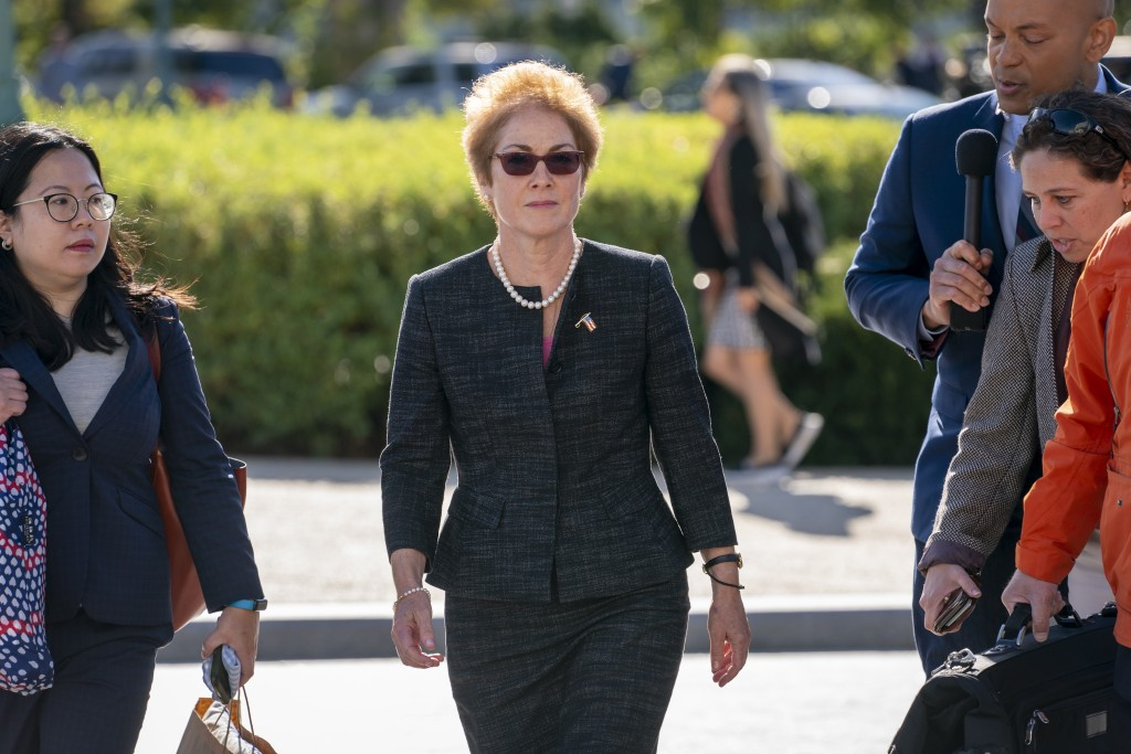 FILE - In this Oct. 11, 2019, file photo, former U.S. ambassador to Ukraine Marie Yovanovitch, center, arrives on Capitol Hill, Friday, Oct. 11, 2019,...