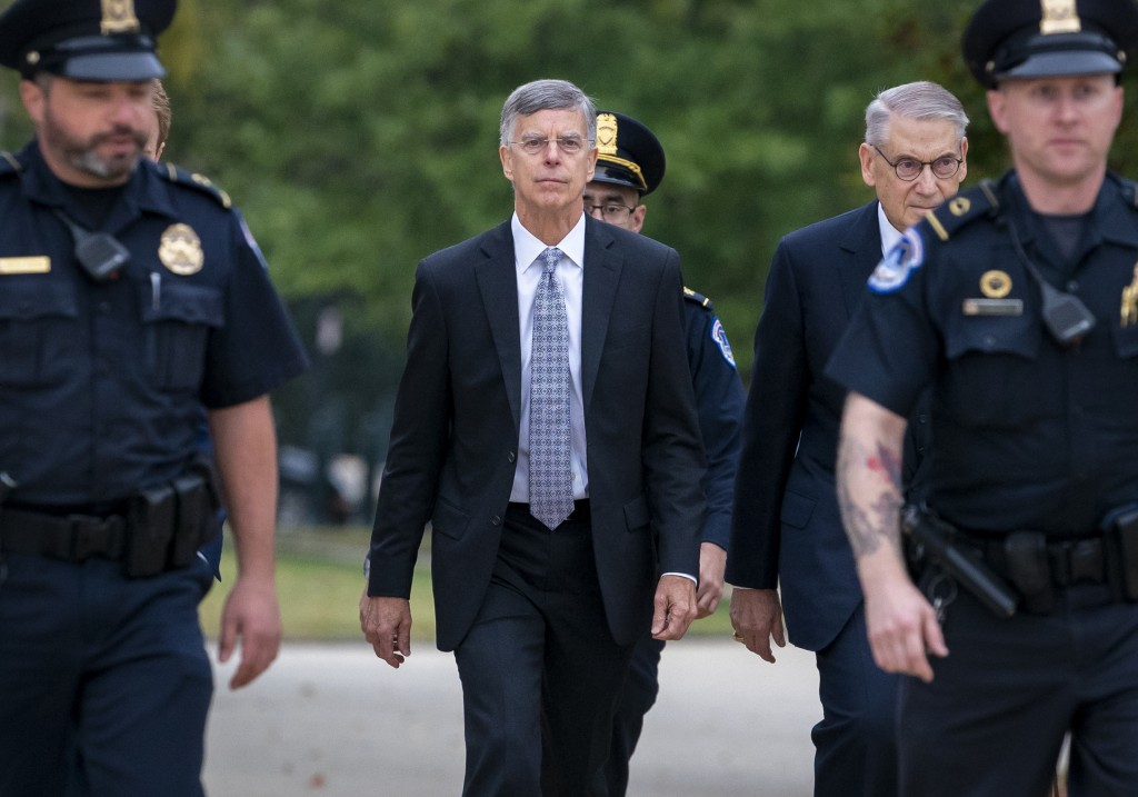 FILe - In this Oct. 22, 2019, file photo Ambassador William Taylor, is escorted by U.S. Capitol Police as he arrives to testify before House committee...