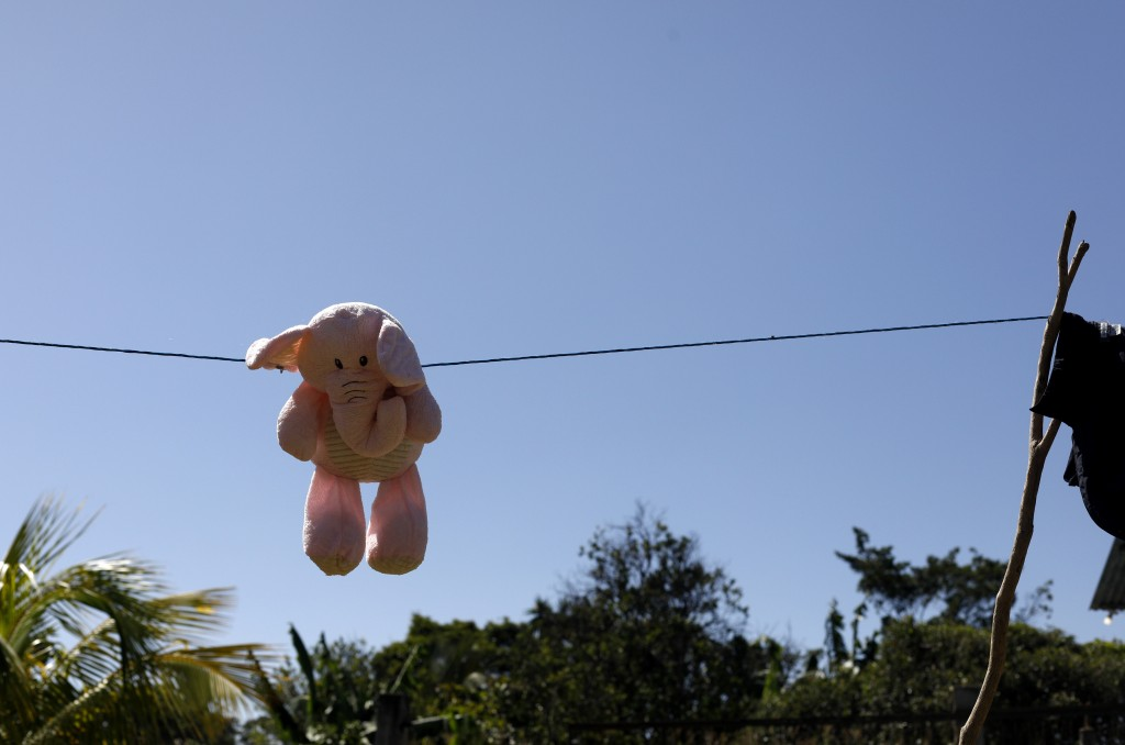 This Aug. 23, 2019, photo shows a stuffed animal hanging to dry at the Comayagua, Honduran home of a 3-year-old who was separated from her father when...